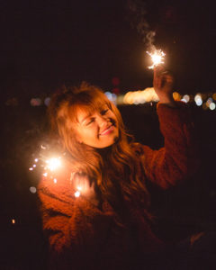 Lovely senior picture with sparklers in the Quad Cities